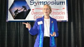 Claudia Speaking at the 2015 Business Women's Symposium